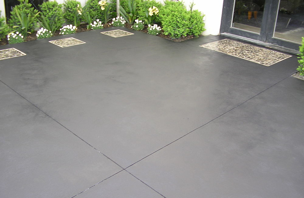 Coloured Concrete Patio with inlaid pavers